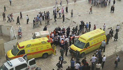 The victim and attacker being loaded onto ambulances (Photo: Magen David Adom)