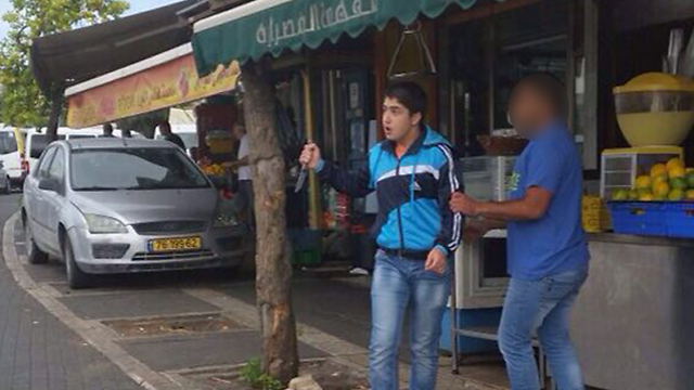 16-year-old assailant with knife in the morning attack (Photo: Tzipi Malkov)