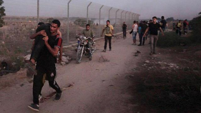 Evacuating the wounded on the Gaza border.