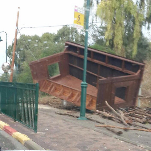 An overturned bus stop in Moshav Udim - the result of heavy winds.