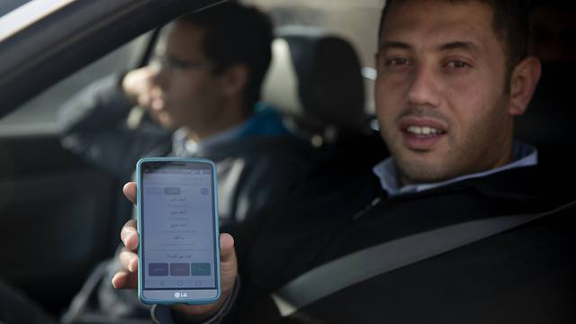 A Palestinian in Qalandiya using mobile apps to navigate heavy traffic - soon to be in 3G. (Photo: AP)
