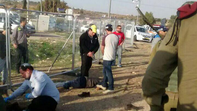 On the left: Treating the wounded victim, on the right: Guns-drawn pointed at the terrorist (Photo: Elisaf Hillela)