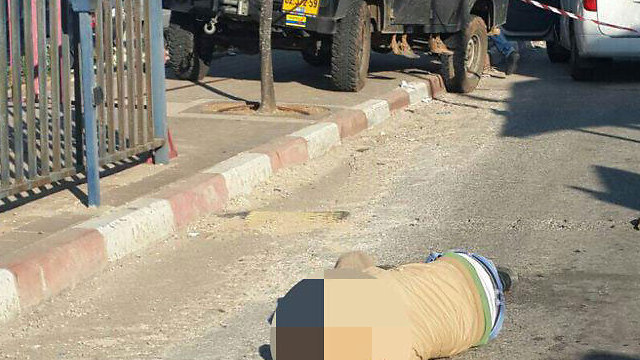 The terrorist after he was shot and neutralized (Photo: Hatzalah)