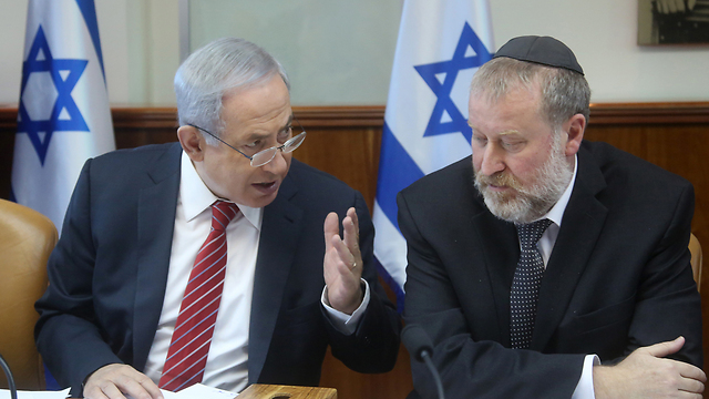 Netanyahu (L) doesn't want and isn't demanding a quick decision in his cases; Mandelblit, it seems, isn't interested in making a quick decision (Photo: Marc Israel Sellem)
