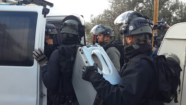 Police with the shooter's computer. (Photo: Hassan Shaalan)
