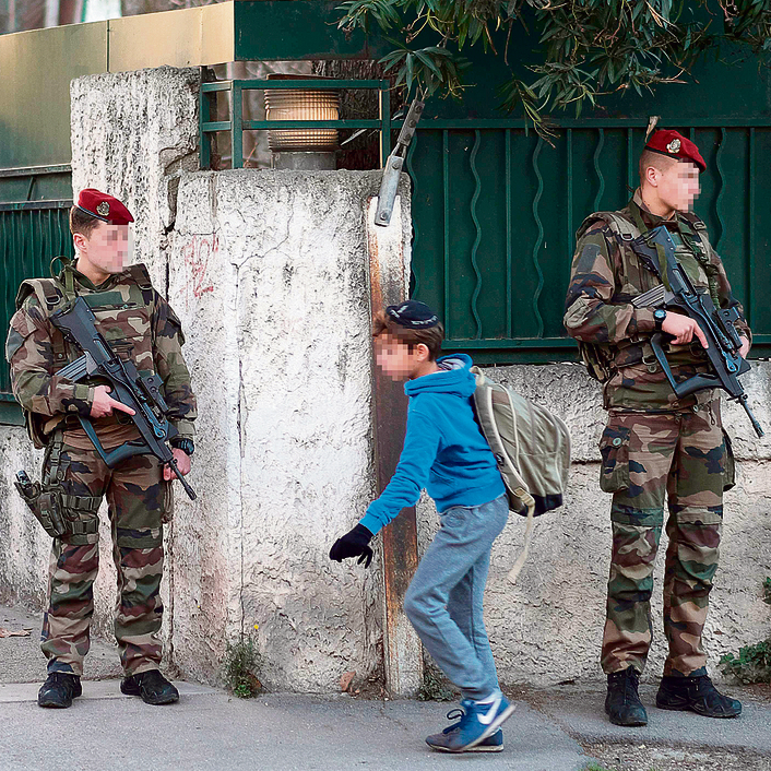 Police officers guard a Jewish school in Marseille (Credit:AFP)
