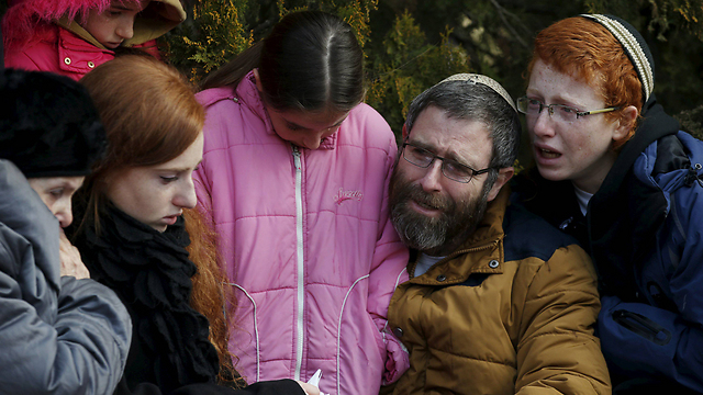 Natan and four of the couple's children at the funeral (Photo: Reuters)