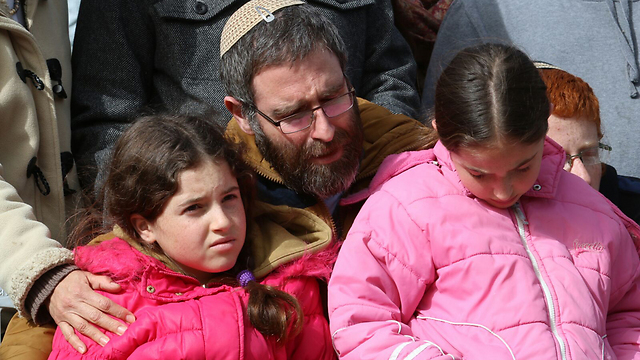 Natan Meir and two of the Meirs' daughters (Photo: Hillel Meir/TPS)