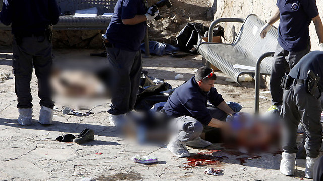 Bodies of the terrorists after the terror attack in the Damascus Gate, Jerusalem (Photo credit: AFP)
