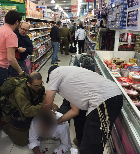 One of the wounded being treated at the scene of the attack (Photo: Uziel Vatik) (Photo: Ozel Vatik)