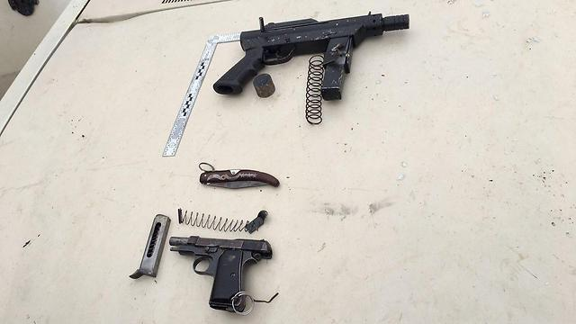 Terrorists' handgun and submachine gun (Photo: IDF spokesperson)