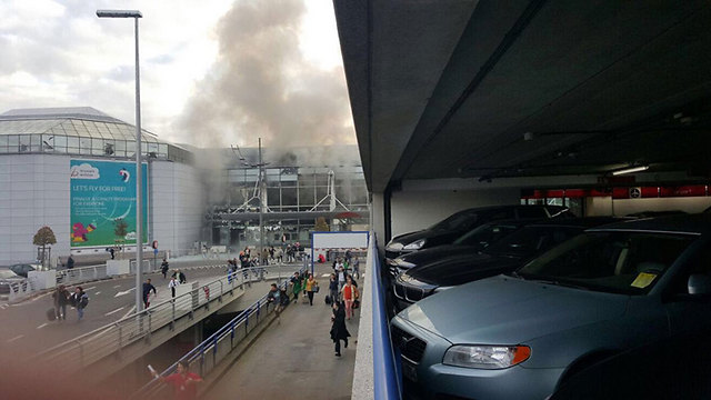 Smoke from explosions at Brussels airport