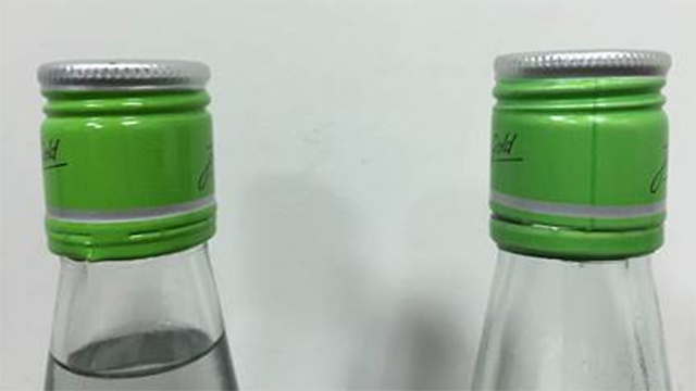 Fake bottle has vertical dark green line on cap, real bottle has no line. (Photo: Ministry of Health)