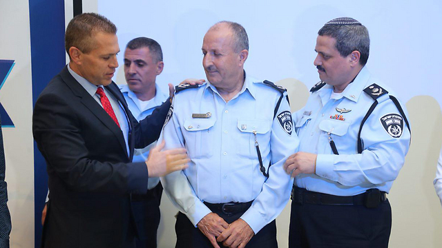 Minister of Public Security Gilad Erdan (L) and Police Commissioner Roni Alsheikh (R) promoting Arab officer Jamal Hakrush (C) to the rank of Deputy Commissioner (Photo: Motti Kimchi) (Photo: Motti Kimchi)