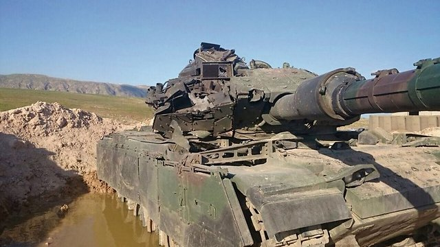 Turkish Tank which was hit by ISIS anti-tank missile. The tank and crew survived thanks to Israeli upgrades