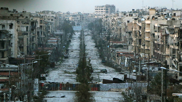 A destroyed street in Aleppo. Assad's actions have led to the deaths of about 400,000 people so far. (Photo: Reuters)