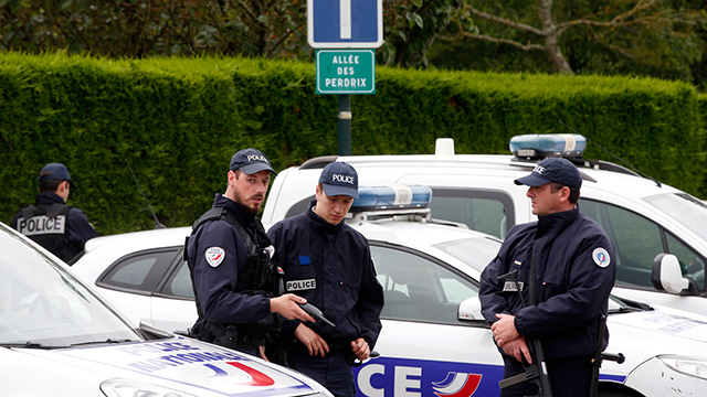 French police outside of home of slain police officer and his partner (Photo: AP)