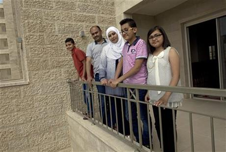 The al Khateeb family gather for a photo on the terrace of their newly delivered apartment.