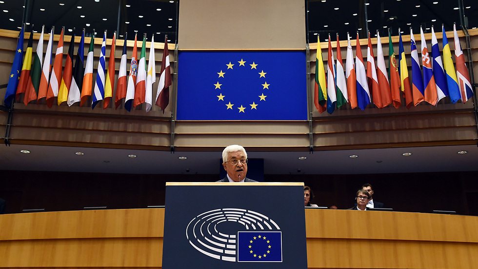 PA President speaking before EU Parliament and alleging rabbis and Israeli government poison Palestinians (Photo: AFP) (צילום: AFP)