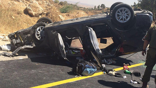 The Mark family car after having flipped over (Photo: Judea and Samaria Fire Department, Judea District Station)