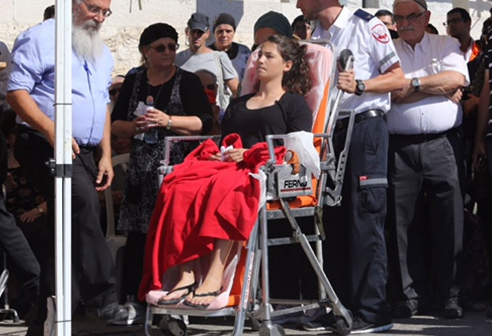 Tehila Mark brought to the funeral on a gurney (Photo: Gil Yohanan)