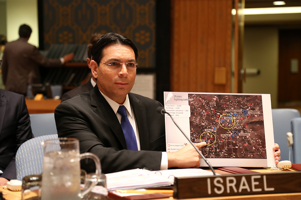 Ambassador Danny Dannon with a photo of Hezbollah infrastructure at the UN