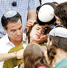 Rabbi Mark's son Pedayah, in green, with his father's cousin Mossad director Yossi Cohen (Photo: Reuters)
