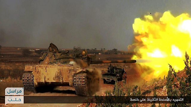A Nusra Front tank in the midt of battle (Photo: AP)