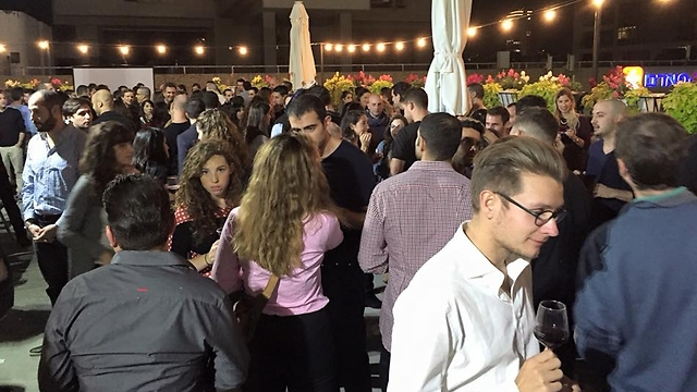 Participants at a rooftop Wine Wednesday event in Tel Aviv (Photo: Wine Wednesday)