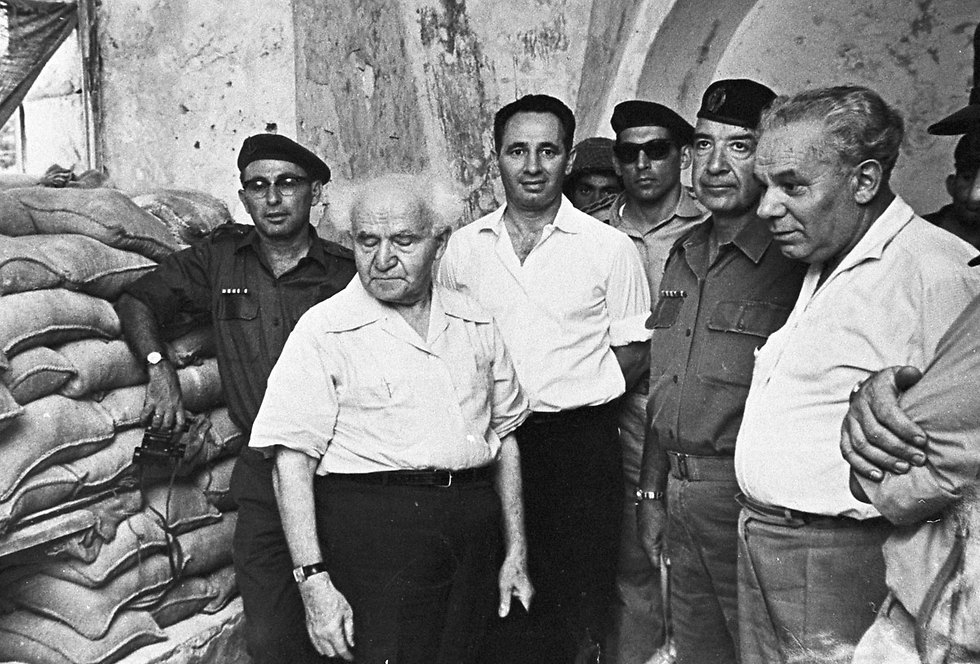 Israel's first Prime Minister David Ben-Gurion with Peres at his left (Photo: David Rubinger)