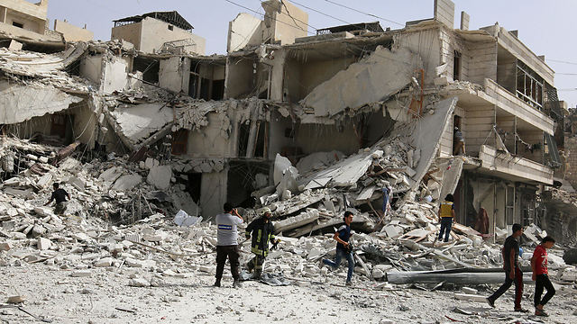 Evacuating the wounded from the wreckage in Aleppo following the recent onslaugh (Photo: Reuters)