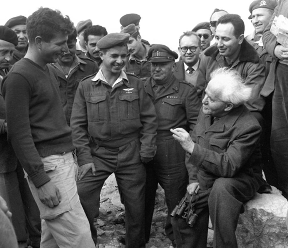 Shimon Peres accompanying David Ben-Gurion at a military visit (Photo: IDF Archive)