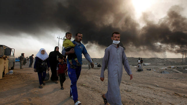 Families fleeing from burning sulphur (Photo: Reuters