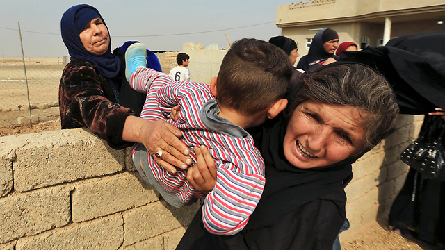 Refugees flee Mosul, Iraq. The world watches, knows and keeps quiet (Photo: AP)