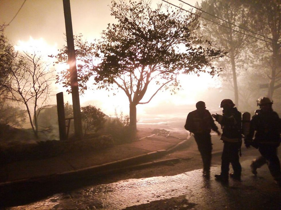 Fire in the settlement of Halamish (Photo: Judea and Samaria Fire Department Spokesperson's Unit)
