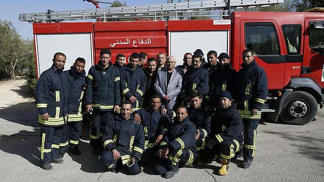 Palestinian firefighters after helping to extinguish Nahf fire (Photo: AFP) (Photo: AFP)