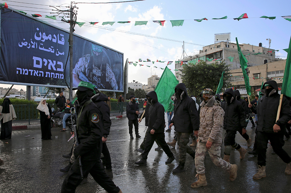 The large sign says in Hebrew and Arabic 'Coming from underground' (Photo: AP)