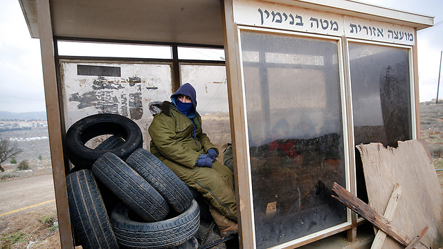 Settlers preparing for the Amona evacuation (Photo: Reuters)