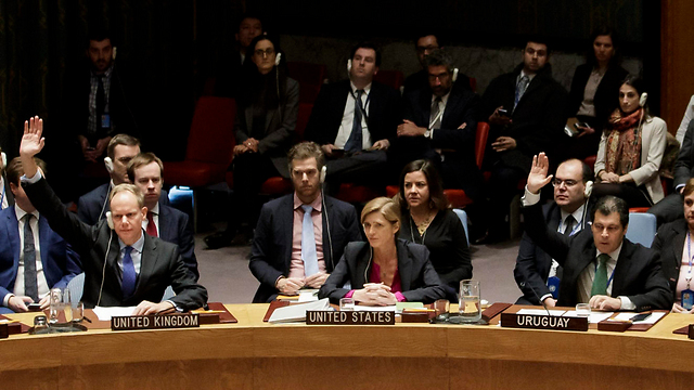 UK and Uruguay voting to adopt the resolution as the US abstains (Photo: EPA)