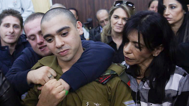 Sgt. Azaria with his mother in court (Photo: Flash90)