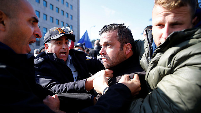 Protesters clash with police (Photo: Reuters)