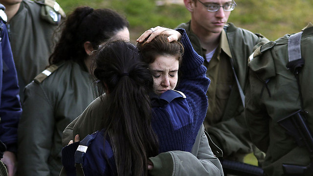 Soldiers comforting one another at the scene of the attack (Photo: AFP)