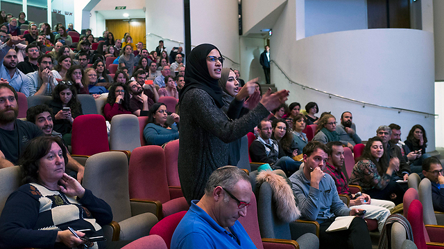 An Arab student disrupts Syrian speakers at peace conference (Photo: EPA)