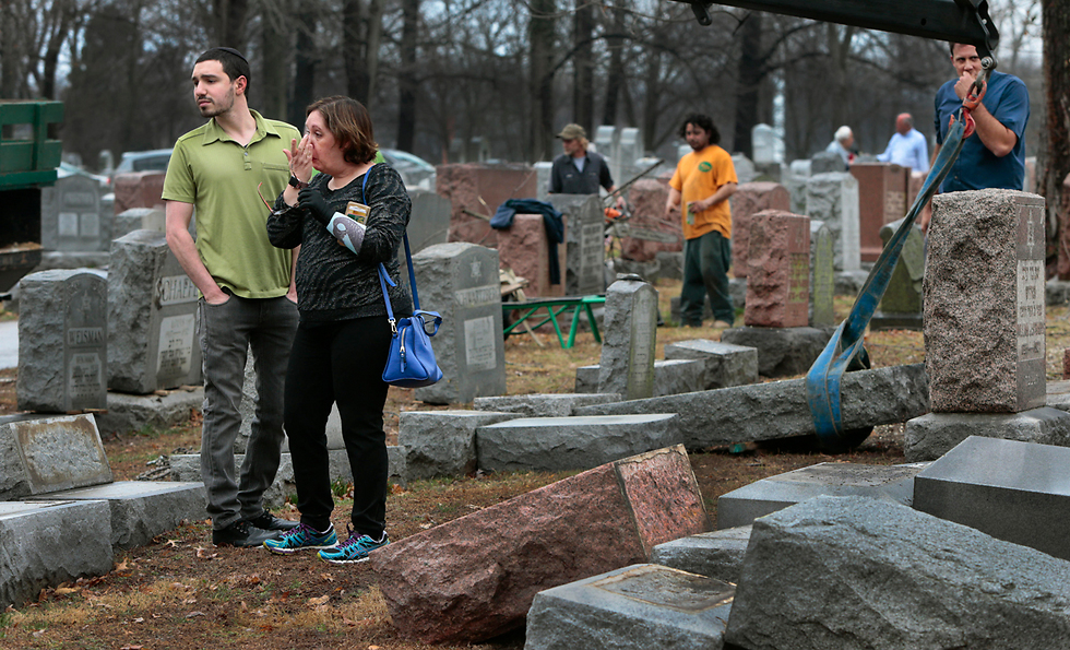 Family members visit the vandalized gravesite (Photo: AP)