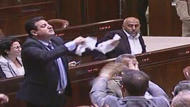 Ayman Odeh tears up the bill from the floor (Credit: Knesset Channel)