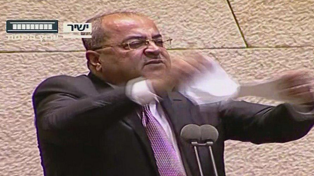 Ahmad Tibi tears up the bill from the podium (Credit: Knesset Channel)