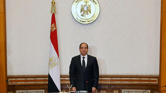Egyptian President el-Sisi stands and observes a minute of silence for the victims of the attack (Photo: Reuters)