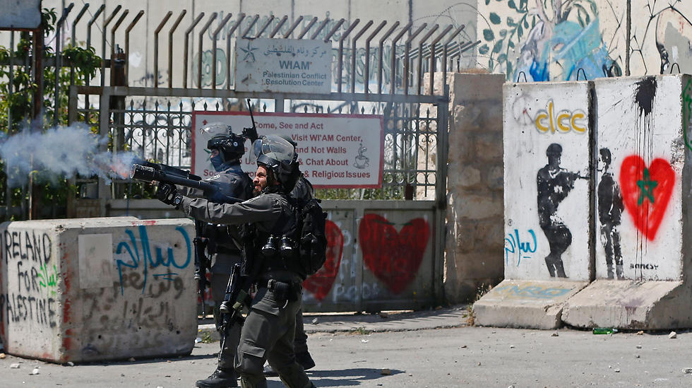 Israeli security forces fire tear gas towards Palestinian protesters during clashes following a demonstration in the West Bank town of Bethlehem. (Photo: AFP)