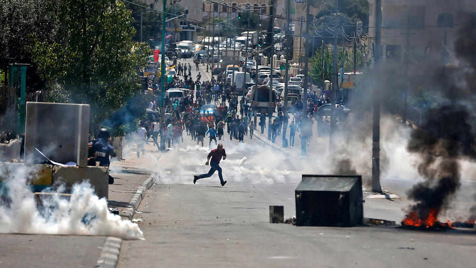 Palestinian protesters hurl stones towards Israeli security forces during clashes following a demonstration in the West Bank town of Bethlehem. (Photo: AFP)
