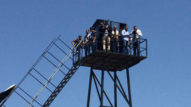 Journalists on Hezbollah's tour observing the Lebanon-Israel border
